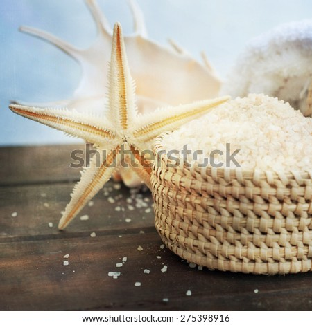 Spa and wellness setting with natural bath salt, candles - stock photo