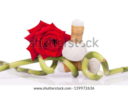 Spa and wellness setting with natural soap, candles and towel - stock photo