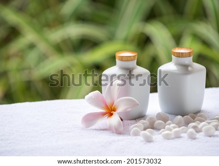 Spa and wellness setting with natural soap, stones and towel on the green background . Concept spa. - stock photo