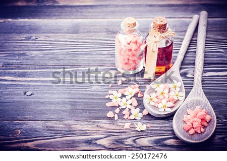 Spa, aromatherapy and body care. Essential massage oil, sea salt and flowers - stock photo