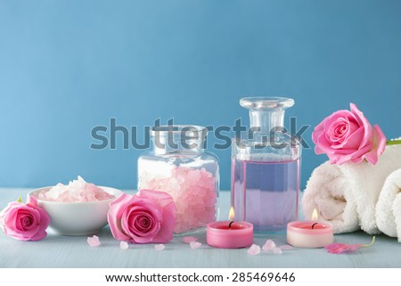 spa aromatherapy with rose flowers perfume and herbal salt - stock photo