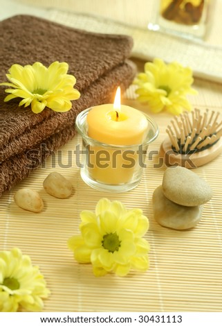 Spa background. towel, flowers, stones and candle
