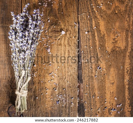 Spa background with bunch of lavender and sea salt. - stock photo