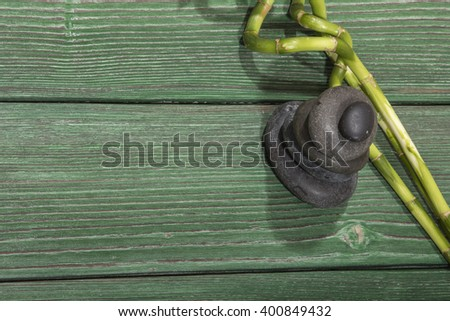 spa bamboo on green wooden background - stock photo