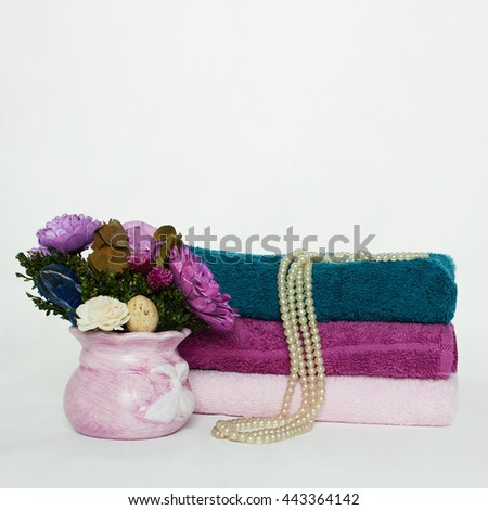 spa Bath still life.towels and flowers - stock photo