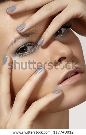 Spa, beauty, skincare, wellness & health. Glamour close-up portrait of beautiful woman model face with purity healthy skin & silver make-up and grey manicure. Cold winter christmas makeup - stock photo