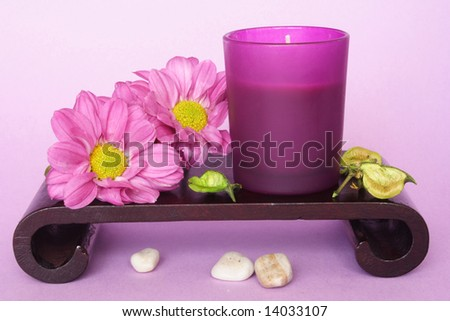 Spa candle and flowers in color background - stock photo