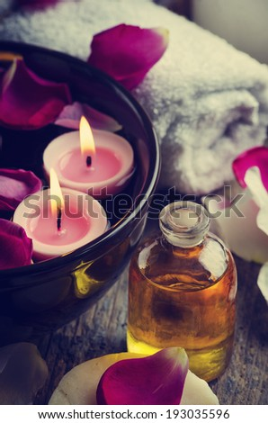 Spa candles and massage oil. retro filter - stock photo