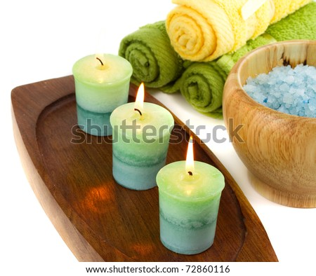 Spa candles and towels isolated on white