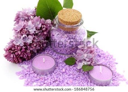 spa composition of candles, bottle and flowers lilac - stock photo