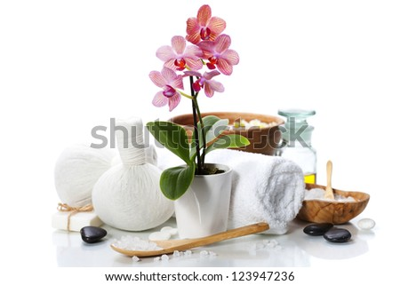 spa composition with beautiful pink orchid over white - stock photo
