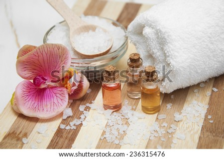 Spa composition with flowers on table on wooden background - stock photo