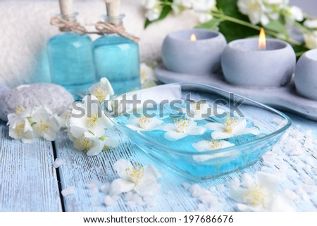 Spa composition with jasmine flowers on table close-up - stock photo