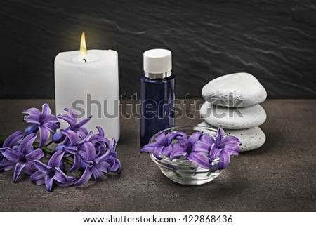 Spa composition with spring flowers on grey background - stock photo