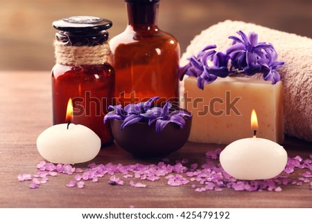 Spa composition with spring flowers on wooden table - stock photo