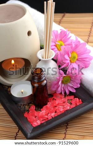 Spa Concept: bottle of essential oil, massage stones,candles,flower and bath-salt - stock photo