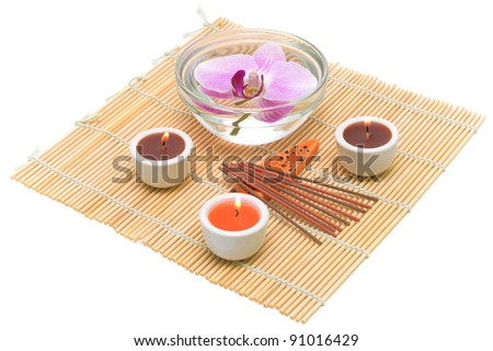 Spa concept (candles, incense sticks and orchid) on a white background - stock photo