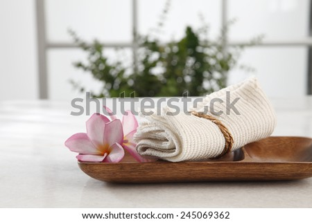 spa concept flower and the hand towel in a bath room - stock photo