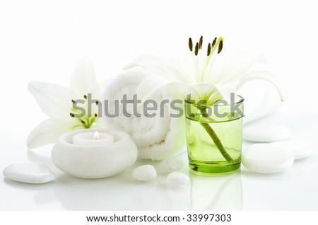 Spa concept (flowers, towel, candle and pebbles). White background - stock photo