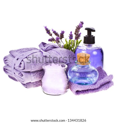 spa concept - towels, aromatic salt, gel, avender water, lavender flowers isolated on white background isolated on white background