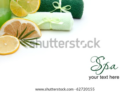 Spa concept, towels, soap and fruits over white with copyspace