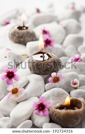 Spa concept - White stones,candles and flowers - stock photo