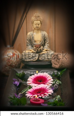 Spa concept with aromaric candles, lavender, buddha, cotton towel, incense diffuser - stock photo