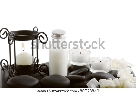 Spa concept with bottle,candles and stone  isolated on white background