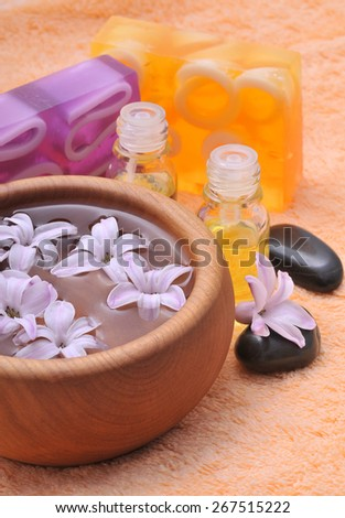Spa concept with flowers and soap - stock photo
