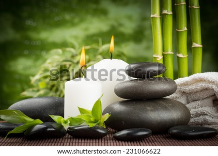 spa concept with zen basalt stones and candles - stock photo