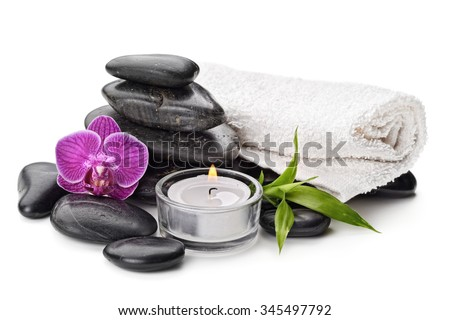 spa concept with zen basalt stones , orchid and candle isolated on white - stock photo