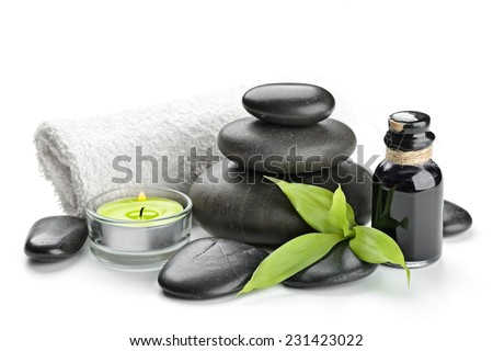 spa concept zen basalt stones and bamboo isolated on white - stock photo