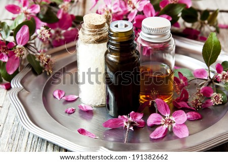 Spa Essences in Bottles with Beautiful Scent FLowers - stock photo