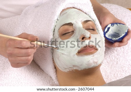 Spa Esthetician Applying Organic Facial Masque - stock photo