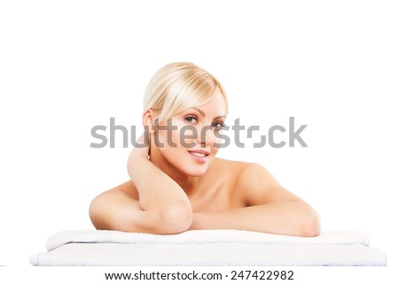 Spa. Face skincare beauty woman smiling happy. Beautiful attractive caucasian female model lying down on towel during skin care treatment isolated on white background - stock photo