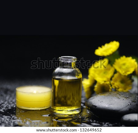 Spa feeling with candle ,stones , massage oil, wet pebbles