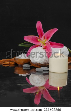 Spa feeling with towel ,candle ,salt in bowl , pebbles, pink lily - stock photo