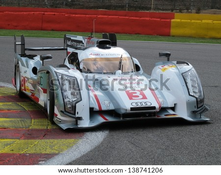SPA-FRANCORCHAMPS, BELGIUM - MAY 2: An Audi R18 e-tron quattro race car in the La Source hairpin during round 2 of the FIA World Endurance Championship on May 2, 2013 in Spa-Francorchamps, Belgium. - stock photo