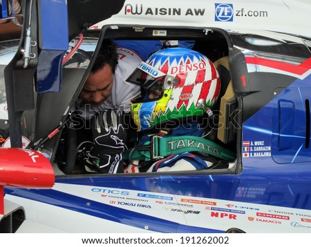 SPA-FRANCORCHAMPS, BELGIUM - MAY 1: Austrian race car driver Alex Wurz (Toyota TS 040 - Hybrid) during round 2 of the FIA World Endurance Championship on May 1, 2014 in Spa-Francorchamps, Belgium.  - stock photo
