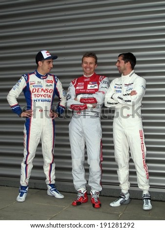 SPA-FRANCORCHAMPS, BELGIUM - MAY 1: Swiss drivers Sebastien Buemi, Marcel Fassler and Neel Jani during round 2 of the FIA World Endurance Championship on May 1, 2014 in Spa-Francorchamps, Belgium.  - stock photo