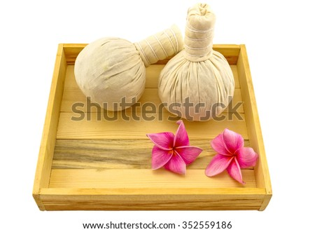 Spa herbal compressing ball , pink frangipani flowers (Plumeria spp , Apocynaceae, Pagoda tree, Temple tree) in wooden box isolate on white background - stock photo