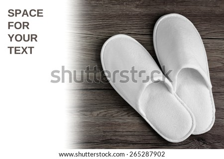 Spa, hotel - home slippers close on wooden background with white space for text - easy remove text - stock photo