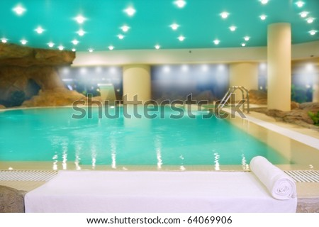 spa indoor turquoise saloon water white towel lights ceiling - stock photo
