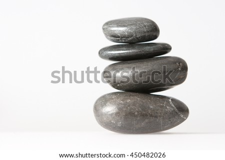 spa la stone health therapy pebbles stack isolated on white - stock photo
