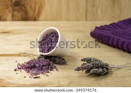 Spa Lavender bath salts on white bottle with a purple towel - stock photo