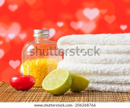 Spa massage border with towel stacked red candle and lime on hearths decoration background for valentine day - stock photo