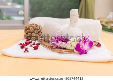 Spa massage compress balls, herbal ball on the wooden with treaments spa , Thailand