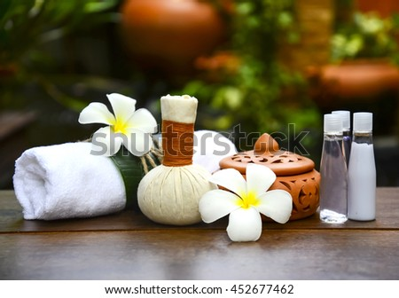 Spa massage compress balls, herbal ball on the wooden with treaments spa , Thailand, select focus  - stock photo