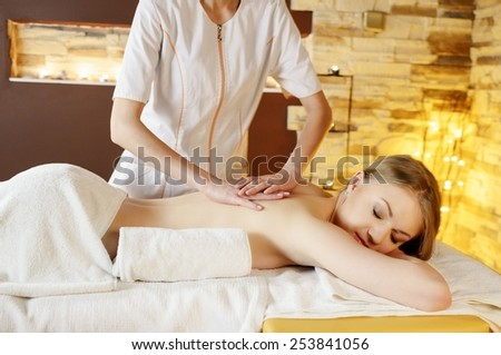 Spa massage for beautiful pretty woman back - stock photo