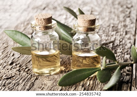 spa oil on a wooden table close-up  - stock photo
